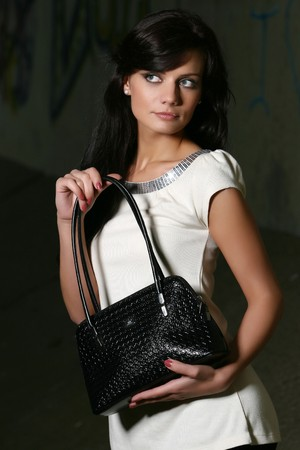 cute brown haired girl model with luxury handbag Stock Photo