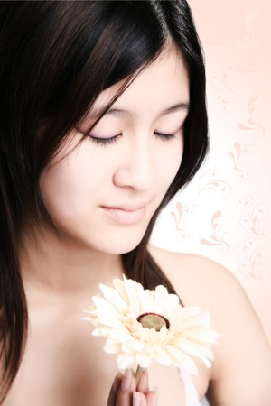 Perfect sweet asian girl with flower is doing meditation and relax photo