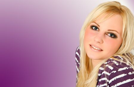 affability: very cute blond haired girl is smiling frontal into the camera with purple background, violet shirt and radiation with white stripes. very beautiful. Stock Photo