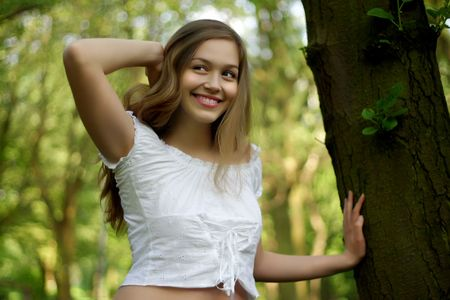 cute young girl in spring nature photo