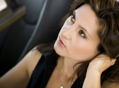 Close up of pretty MILF Woman with perfect skin in hot car
