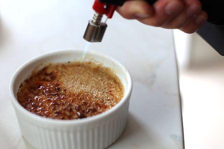 creation of flambe creme brulee, fire burner Stock Photo