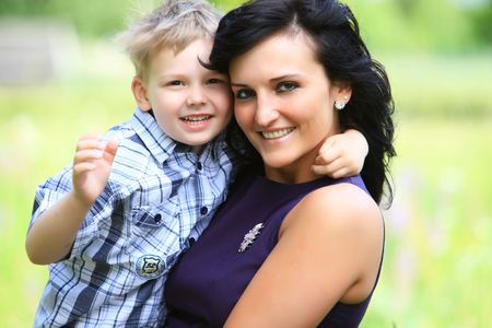 lovely cute boy and young mother