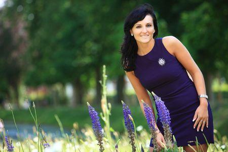 Beautiful woman with purple summerdress near lavender