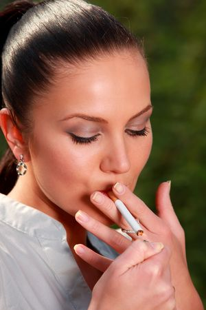 lighter: business woman makes a break and start smoking cigarette