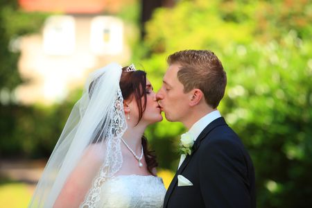 Tender wedding kiss. Young couple is kissing each other after wedding. wedding kiss. Stock Photo