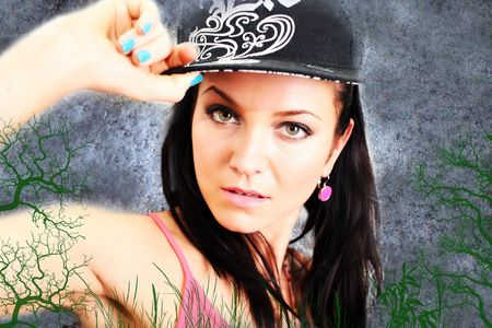slut: Beautiful brunette girl with pink earrings and a nice hiphop cap and pretty clear eyes. Stock Photo