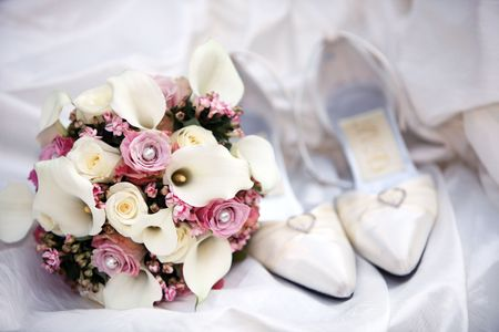 bridal bouquet: bridal bouquet posy with wedding shoes. very nice decoration before the zenith Stock Photo