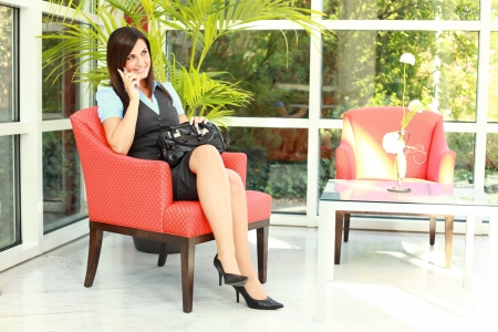 business woman legs: Attractive Business woman is on the phone with high heels