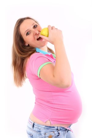 Pregnant woman is eating an apple photo