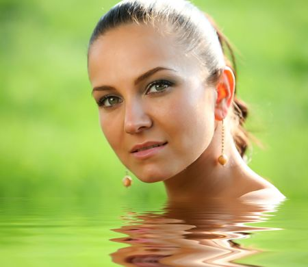 wavily: Cute brown haired portrait photo of a ncie young caucasian girl with some water mirroring reflection. Perfect skin and nice green eyes.