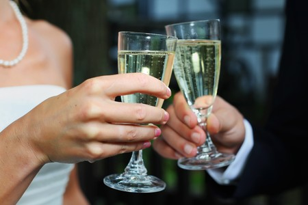 wedding toasting glasses. Bride & groom toasting with champagne or sparkling wine Stock Photo - 7693688