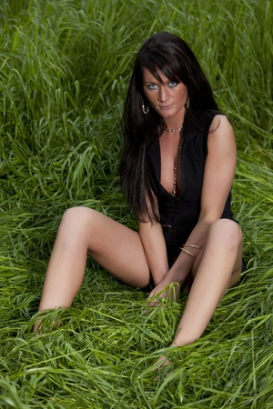 haired: long haired sexy girl in green grass spring on way to summer