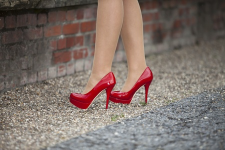 Woman feet and downer legs in red high heels Stock Photo