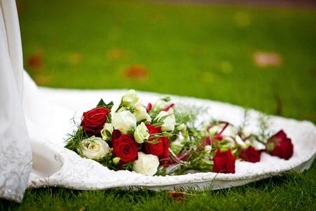 Wedding roses on dress Stock Photo