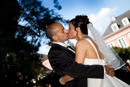 interracial marriage: wedding kiss