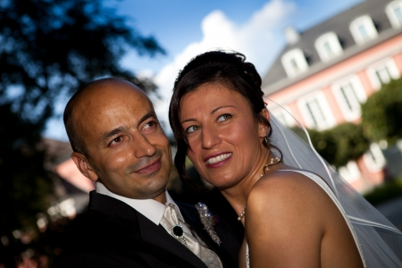 wedding portrait with blue sky and veil of turkish and tunisian wedding photo