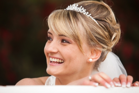 Funny laughing bride portrait  Face photo of a beautiful happy and pretty bride with diadem in her hair