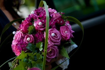 purple rose: purple bouquet with silver pearls and some green Stock Photo