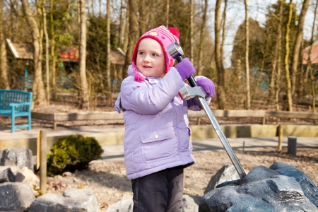 children on playground with excalibur sword