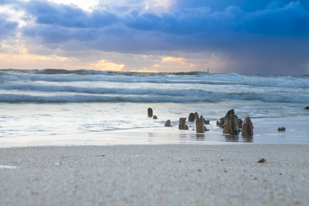 Groin to protect the sandy beach coast - thunderstream in the background - rainfront si coming - climate change Stockfoto