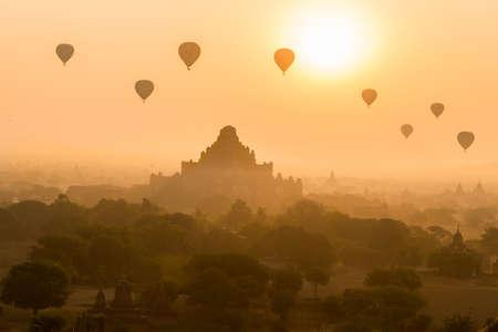 Dhammayangyi Pagoda and Hot air balloon at sunrise , Bagan , Myanmar