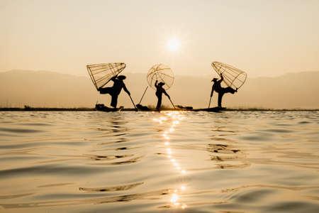 Fisherman Silhouette at Sunset, Inle lake, Myanmar , Burma Stock Photo