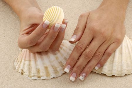 nicely: Very nice hands in the sand Stock Photo