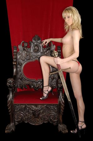 sword act: A sexy woman on a throne