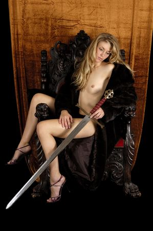 A sexy woman is sitting an a throne Stock Photo - 2327675