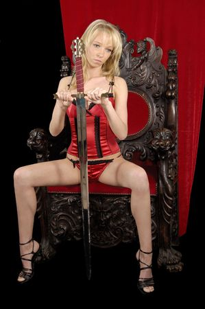 throne: A sexy woman is sitting an a throne