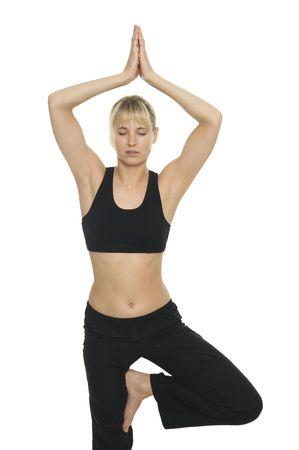 A happy woman does yoga Фото со стока
