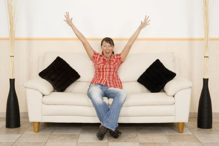 A woman shout on a couch Stock Photo - 5165270