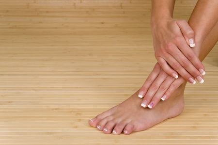 manicured: beautiful hand and foot with fresh manicured nails Stock Photo