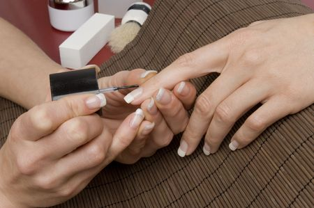 naildesign: beautiful hands getting a manicure