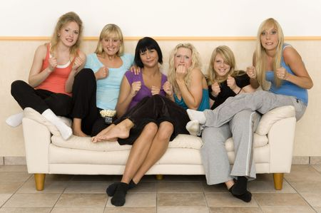 thriller: beautiful young girls watching a thriller Stock Photo