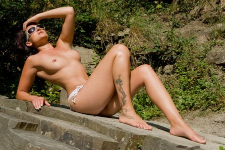 nude outdoors: Woman with erotic pose outdoors