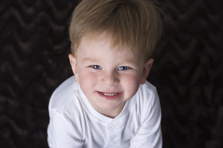 tiddler: Portrait of happy baby boy   Stock Photo