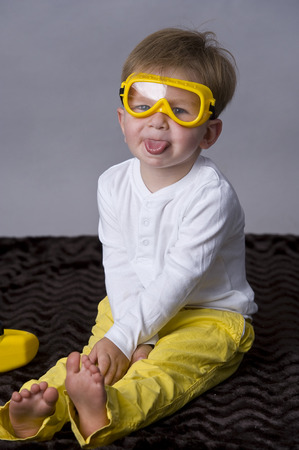 tiddler: Portrait of happy baby boy  sitting