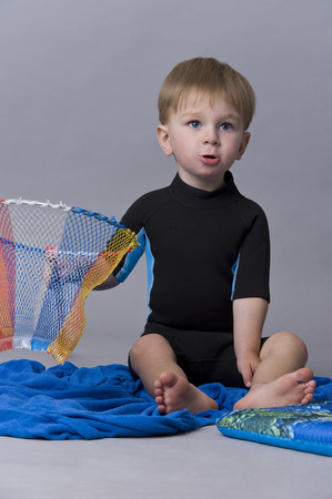 tiddler: Portrait of happy baby boy playing with a net
