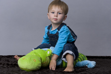 tiddler: Portrait of happy baby boy playing with his toy Stock Photo