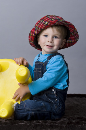 the infancy: Portrait of happy baby boy playing with his toy Stock Photo