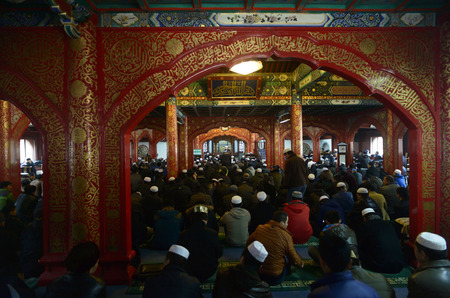 muster: Muslim people pray in Nuijie mosque, Beijing, China