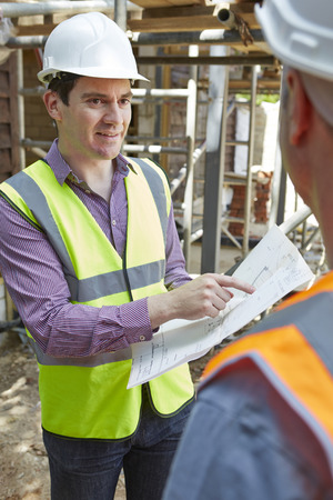 outoors: Architect Discussing Plans With Builder