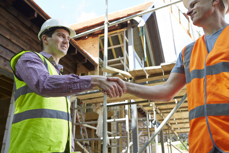 high visibility: Architect Shaking Hands With With Builder