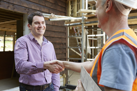 shaking hands: Customer Shaking Hands With Builder Stock Photo