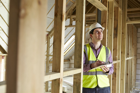 inspector: Building Inspector Looking At New Property Stock Photo
