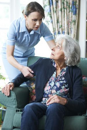 mistreatment: Care Worker Mistreating Senior Woman Stock Photo