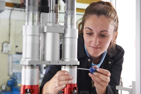 engineer: Engineer Working On Machine In Factory