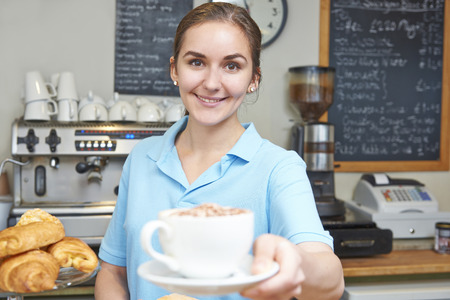 making coffee: Waitress In Cafe Serving Customer With Coffee Stock Photo